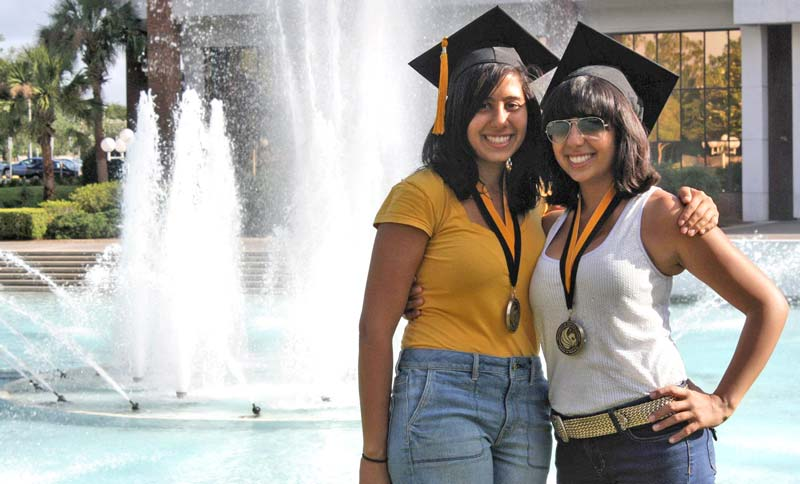 Anna Eskamani and her sister Ida standing in front of a fountain at the UCF main campus
